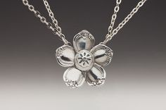 Flower necklace made with tops of spoon handles.