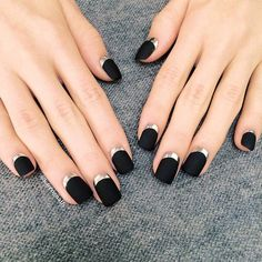 For a twist on the classic French mani, place the accent at the base of your nails, creating a silver half moon design against a flat black polish. Get our handy half-moon tutorial and tips here.