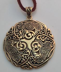 - Celtic Norse 3 Wolf Triskele Triskelion Pendant - in gold tone Jeweler's bronze. - Gorgeous details! Celtic spirals adorns the 3 Wolves as they circle around the central Triskele. - Designed by arti