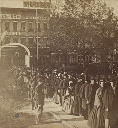 A line of people await entry into the Illinois State Capitol to view  President Abraham Lincoln's body in Springfield, Illinois. Toward the front  of the lin...