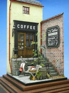 """Coffee shop by Doozy."" I like this idea, to just make a facade, it could include so much detail but with minimul space."