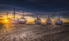 Thorup Strand - Four fishing vessels at Thorup Strand in Denmark
