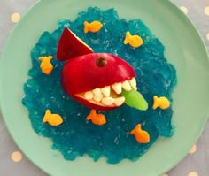 Shark Attack Snack: Spoon the blue jello around the shark and add the gold fish. We had gummy Swedish Goldfish so we put one of those in his mouth.