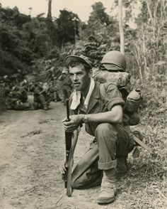 WWII soldier alert with watchful eye while others take a break in Burmese jungle. Photographer Unknown.