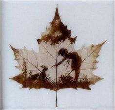 map leaves_carving_masterpieces art9 Girl with bunnies carved on a maple leaf
