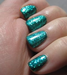 these are kinda like mine right now! but mine are the matte light minty green/aqua color with glitter ontop! yay!