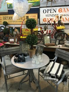 Great metal table & chairs in the industrial booth at The Agoura Antique Mart!