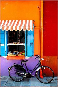 Burano is a small island located near Venice, famous for its bright colours reflecting intothe green water. Legend says that the island's fisherman painted their houses so they could see the…