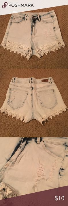 Ripped lace jean shorts Slightly high waisted jean shorts! Has rip on the front and back pocket (came that way) as well as dark washes throughout with lace for a fun detail! Shorts Jean Shorts