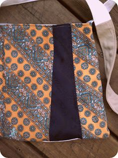 I opened up the neckties and ironed them flat then sewed them together.