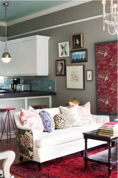 upholstering the back of the couch with a different contrasting fabric...great idea