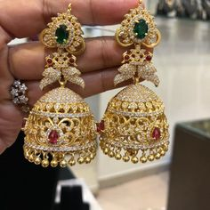 Items similar to Jhumkas-Jhumka Earrings-Traditional Jhumkas/Earrings in Gold Polish with American Diamonds,Ruby's,Emeralds,Gold color Beads on Etsy Gold Jhumka Earrings, Gold Bridal Earrings, Jewelry Design Earrings, Gold Earrings Designs, Gold Jewellery Design, Bridal Jewelry, Necklace Designs, Gold Jewelry, Gold Necklace