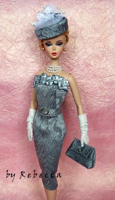 Barbie in grey strapless cocktail dress