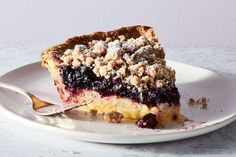 A lemon and blueberry pie topped with streusel.
