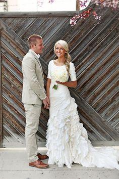 Modest wedding dress with ruffly train