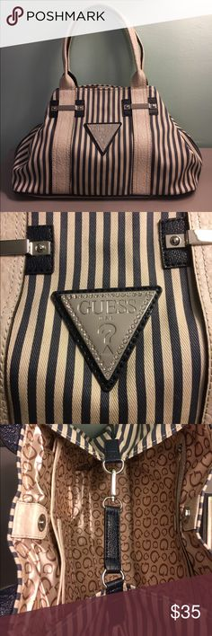 Guess Navy and Cream Striped Handbag Navy and cream striped canvas shoulder bag with triangle guess symbol label lined with faux crystals.  Inside includes one zipper pocket and three open pockets.  The main compartment has a clip system to keep the triangular shape of the bag and a magnetic closure as seen in the picture.  This bag is in excellent condition. Guess Bags Shoulder Bags