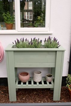green standing waist-height planter with shelf DIY - perfect for adding height and greenery to a patio or balcony and to create an easier way to grow herbs or flowers for those who have issues with mobility. #diy #diygarden #planter #diyplanter #diyraisedplanter #raisedstandingplanter #raisedbed #raisedbeddiy #uk Raised Planter Beds, Raised Beds, Diy Planters, Growing Herbs, Greenery, Balcony, Garden Ideas, Shelf, House Ideas