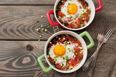 These healthy baked eggs are one of my favourite breakfasts! They are super easy to make at home, everyone will love them. Serves 2 (Using 5-inch diameter ovenproof ramekins/dishes) Ingredients:1 tbsp olive oil½ medium brown onion1 garlic clove, crushed½ tsp chilli flakes2 cups fresh baby spinach200g canned crushed tomatoes150g canned cannellini beans, drained, rinsedSalt and pepper, to taste2 large eggs2 spring onions, chopped  Method:  Preheat the oven to 205C/400F and lightly grease two…