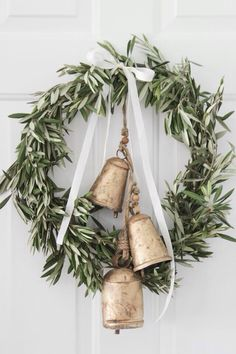 Such a gorgeous wreath! This would be so easy to make for the upcoming winter holidays, & it's perfect for any type of decor. We just love the bells!