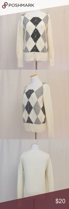"""Argyle Cardigan with Gold Embroidered Detail Soft and pretty. This cardigan is perfect for staying cozy in the office. Cream with gray diamonds and gold threading throughout. Cute jewel buttons add a little extra to this pretty sweater. There is some pulling and a few snags. Tiny makeup spot near collar about the size of a pin head.  Length 25"""", bust 22, Sleeves 25"""". Old Navy Sweaters Cardigans"""