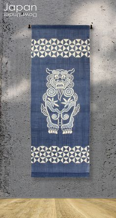 A beautiful aizome wall hanging. It was made in Okinawa and is hand dyed in aizome (indigo) blue, a traditional color found in fabrics and pottery in this area. The hand stenciled shisa lion dog, in various shades of indigo blue is bordered by geometric shaped lines#aizomelinen #wallhanging #indig0shisa #tapestry #indigowalihanging #handdyedwallhanging by #JapanDownUnder on #Etsy Original Godzilla, Indigo Walls, Colored Bubbles, Indigo Plant, Japanese Wall, Lion Dog, Framed Art, Wall Art, Good Spirits
