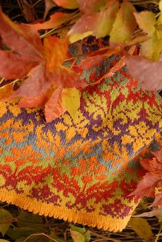 Leaf pattern is DAMASK by dale of norway. Yarn is at least two colourways of Kauni