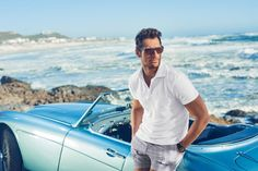 David Gandy pictured in a polo shirt and plaid shorts from his Autograph Beachwear line.