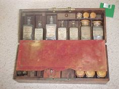 """A French, c, 1840 medical case from the followers of Camphor based theory of treatment by Dr. Raspail.  Raspail was known as the """"poor man's doctor"""".  Fruitwood case with brass corners and handle."""