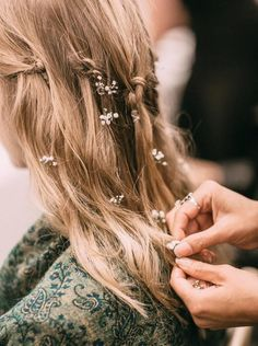 soft and flowy bridal hairstyle with baby's breath and simple knots