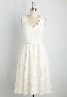 Bedecked in this ivory midi dress - a stunning feature of our ModCloth namesake label - you approach the aisle in a smile as grand as your optimism. A scalloped neckline and gorgeous crocheted lace adorn this pocketed, vintage-inspired A-line, which pair perfectly with the silver linings that detail the day!
