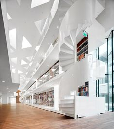 Healthcare Staircase The Learn'd by Kaan Architecten. Dutch studio Kaan Architecten has added a medical research centre to a Rotterdam hospital, featuring triangular skylights, spiral staircases and a 35-metre-high bookcase (+ movie).