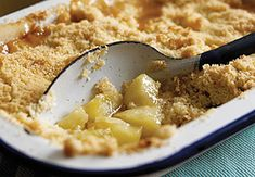 Poached Pear Crumble-1 1/2 cups Nature's Nectar Premium Orange Juice Not from Concentrate; 1/2 cup Brown Sugar; 1 tsp Ground Cinnamon; 1/2 tsp Ground Cloves; 4 pears, peeled and diced; 1/2 tsp Pure Vanilla; 2 T Corn Starch; 2 T cold water; 1/2 cup Apricot Preserves; 1/4 cup Unsalted Butter; 4.8 oz (1 wrapped pkg) Graham Crackers