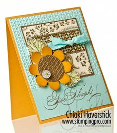 handmake Thanksgiving card ... large paper pieced sunflower anchors a montage of patterned papers and a bow ...