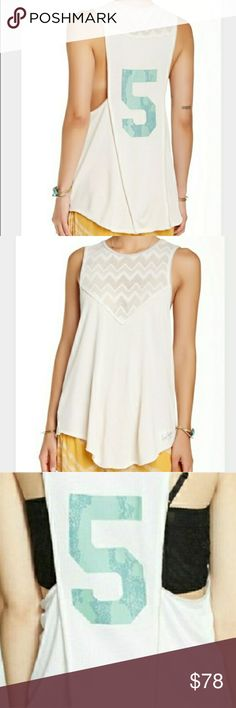 Free People Jersey Tank Free People Jersey Tank. Crochet details. Camo 5 on back. Color is ivory. Curved hem. NWT.   Bust 17 (flat) Length apx 29  No trade or P.P. Reasonable offers considered Bundle discounts Free People Tops Tank Tops