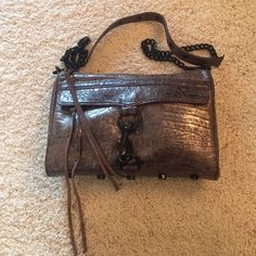 rebecca minkoff MAC crossbody purse gorgeous taupe/ grey/ bronze snakeskin embossed leather MAC purse with black hardware. hardware shows some wear but in overall great condition with lots of life left. inside has 2 open pockets (perfect for cell/ Chapstick) as well as zipper pocket. strap clasp on one side was glued shut so chain can't be removed but the bag is fully functional & in no danger of breaking. no stains. please ask all questions prior to purchasing. all serious offers made via…