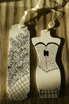 bookmarks.  These are on wood, but they are great graphic inspiration for paper and ink, too.