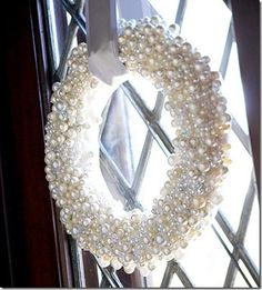 35 Winter Wreaths You Can Make Yourself... This one is just so pretty! Start with a purchased foam ring, cover it with satin ribbon, then glue on crafts store pearls. pretty!