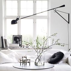 The Flos 265 Swivel Arm Wall Sconce