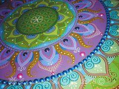 Green-purple Sunmandala with Flower of Life symbol detail painted birch wood with acrylic #mandalaart#mandala#sunmandala#sunmandalasbyje#sun#art#painting#dots#hungary#ancientsymbols#mandalapainting#colors#sacredgeometry#moods#mandalafestés#napmandala#nap#szakrálisgeometria#ősiszimbólumok#hangulatok#színek#magyar