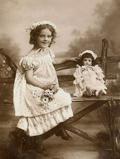 Adorable vintage picture of little girl and her doll.