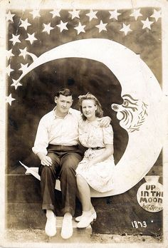 I love these old photos with the moon. Reminds me of Its A Wonderful Life.    We could make a 'photo' area for people to take a picture on the moon? :) to incorporate more IAWL stuff :)
