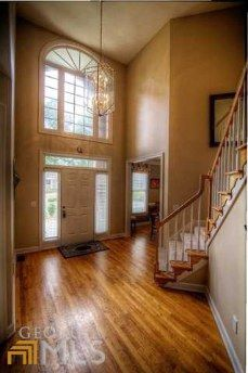 big entryway, chandelier with large window