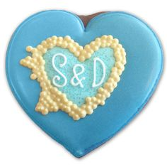 Personalised heart initial biscuit favour - for a wedding by the Great Barrier Reef Down Under!