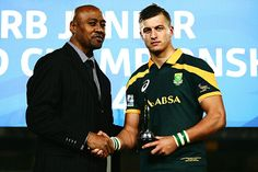 Jonah Lomu presents Handre Pollard of South Africa with the IRB Junior Player of the Year award during the 2014 Junior World Championship Final match between South Africa and England at Eden Park on June 2014 in Auckland, New Zealand. Michael Hooper, Go Bokke, Rugby 7's, Jonah Lomu, South African Rugby, World Championship, Call Up, All Blacks