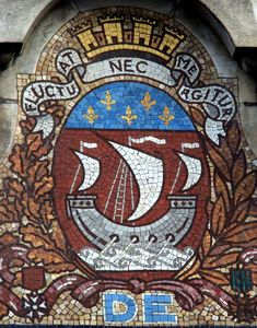 """Baron Haussmann made it official in 1853. That's when """"Fluctuat nec mergitur"""" (""""He who rises with the wave is not swallowed by it"""") became Paris' official motto.  The phrase is also present in the city coat of arms and is symbolized by a ship with one or three poles floating over stormy waters."""