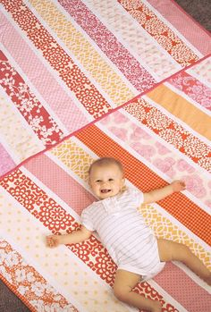 "Quilt in a Day: twelve 4"" strips with 1"" white in between. This would be perfect for a quick baby gift!"