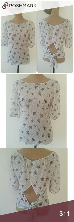 """HP! 🌼  BUNDLE ME Pretty Sheer Cream Floral Blouse Excellent condition  Unique tulip back with bow tie knot design. Fabric is sheer 3/4"""" sleeves with elastic  Brand: Pretty Good Tops Blouses"""