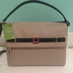 Brand New Kate Spade Purse♥♠ This is a brand new purse that I purchased a few months ago.  It was a bit larger than what I wanted, so I'm selling it.  It's very stylish with taupe leather and black and white accents.  It has a top handle and a long strap for it to function as a cross body purse as well. It's in perfect condition as it hasn't been used. kate spade Bags