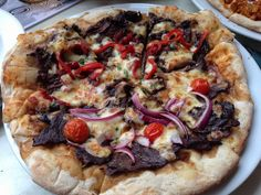 Coat of Arms Pizza from The Australian Hotel Restaurant.  It is half Emu and half pepper Kangaroo with red onion, bush tomato, capsicum and cranberries. #sydney