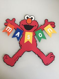 This listing is for an adorable personalized Elmo name sign. Made of premium craft paper. Great to hang on a door or wall as party decor. Approximate size is 10.5 x 10.5 inches Ready to ship in 1-2 business days. See my other listings for matching decor! Please specify name and event